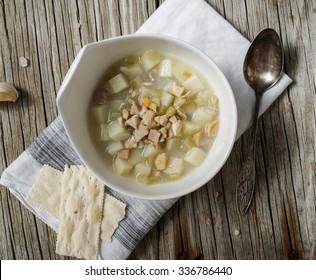 Rhode Island Clam Chowder Soup on Wood Background