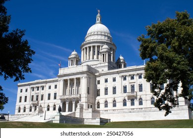 The Rhode Island State House is the capitol of the U.S. state of Rhode Island and is located in the city of Providence shown with some of the surrounding lawn.