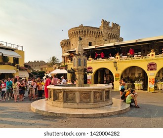 Rhodes, Greece - 07/22/2008: Tourists group on the historic Hippocrates Square, in the Old Town center of the island of Rhodes, Greece.