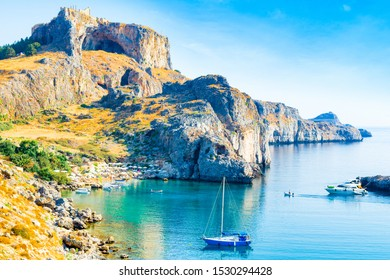 Rhodes, Greece - 14 August 2019: Beautiful mediterranean landscape of Lindos Bay on the Rhodes island, Greece