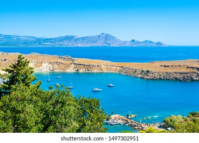 Rhodes, Greece - 14 July 2019: Beautiful mediterranean landscape of Lindos Bay on the Rhodes island, Greece