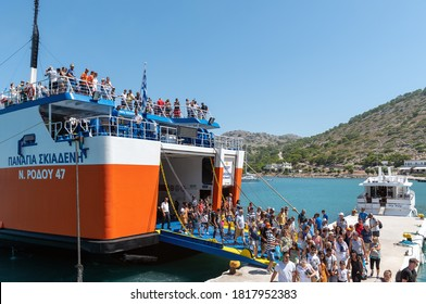 RHODES, GREECE - AUGUST 2020: People are getting off the ship at city port.
