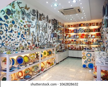 RHODES, GREECE - AUGUST 26, 2017: The handmade souvenir shop in the greek island bazaar. Tourists visit the souvenir markets. Local gift shop selling collection of special products.