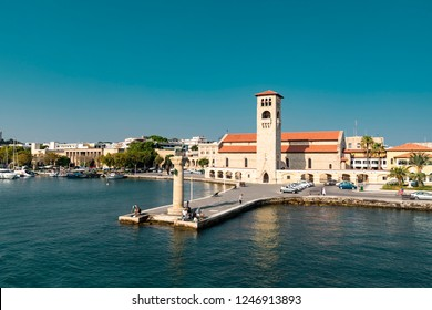 Rhodes, Greece - August 5, 2018: View of the Church of the Evangelismos And Colossus Of Rhodes or hirschkuh statue.