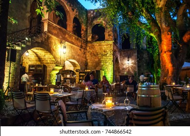 Rhodes, Greece - August 8, 2017: Dinner at a restaurant in the Old Town of Rhodes, night photo