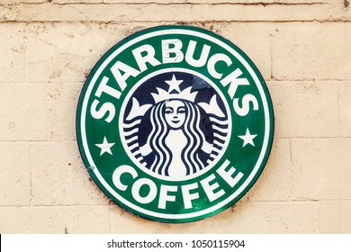 RHODES, GREECE - JULY 07, 2017: Starbucks Coffee metal logo sign on wall, hanging outside of their shop and cafe.