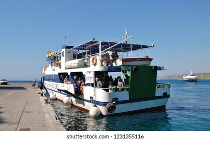 RHODES, GREECE - JULY 13, 2016: Ferry boat Nissos Halki docks at Kamiros Skala harbour on the Greek island of Rhodes. The ferry operates between Rhodes and the island of Halki.