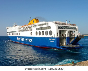 "Rhodes, Greece - July 15 2008: Car-ferry ""Blue Star 2"" sails from Rhodes, bound for Piraeus, on the Greek mainland. Ferries like this provide an essential link for the many Greek islands."