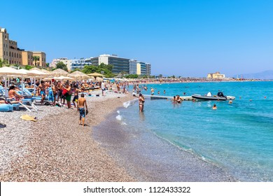 RHODES, GREECE - JULY 4, 2015: People relaxing and sunbathing at Elli Beach, the main beach of Rhodes Town
