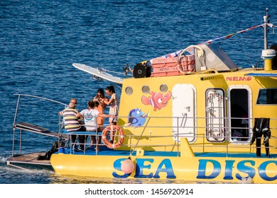 Rhodes, Greece - June 02, 2018.  Small boat cruising with tourist in Port Of Rhodes on sunny day