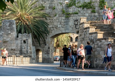 Rhodes, Greece - June 02, 2018. Daytime view Freedom Gate and tourist walking by in Rhodes City