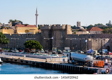 Rhodes, Greece - June 02, 2018. Daytime view of Rhodes port and medieval gate from Naillac Tower
