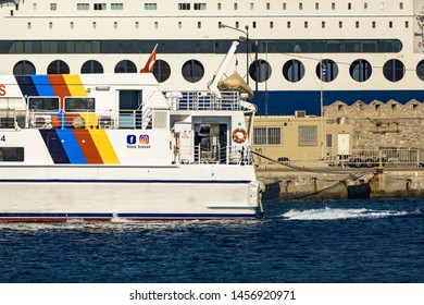 Rhodes, Greece - June 02, 2018. Small and large cruise ships in Port Of Rhodes