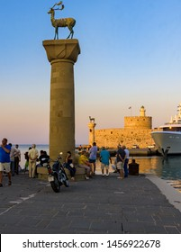 Rhodes, Greece - June 02, 2018. Afternoon view Mandraki Harbour and Hirschkuh Statue in Rhodes City