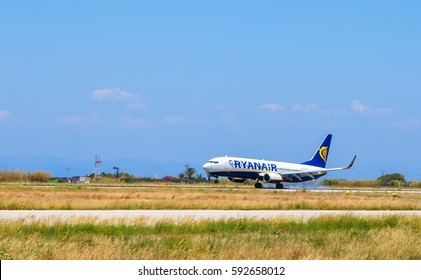 RHODES, GREECE - JUNE 09 2016: Ryanair Airlines plane was taxiing for takeoff in Diagoras airport on background of sea and mountains, Greece Rhodes