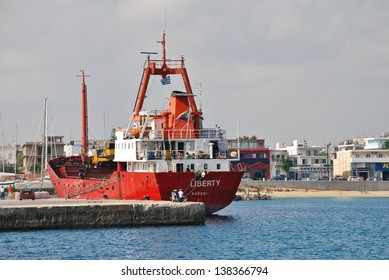 RHODES, GREECE - JUNE 16: Bulk cargo ship Liberty moored at Akantia harbour on June 16, 2011 on the Greek island of Rhodes. The 77 metre ship was built in 1972 in Denmark.