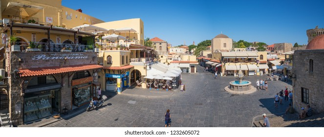 RHODES, GREECE – JUNE 26 2018:  Hippocrates Square with water fountain in Old Town of city of Rhodes.