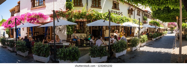 RHODES, GREECE – JUNE 29 2018:  People relaxing in traditional restaurant in city of Rhodes.
