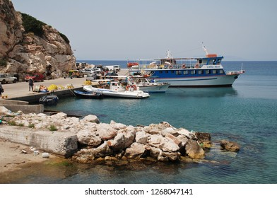 RHODES, GREECE - JUNE 7, 2017: Boats moored at Kamiros Skala harbour on the Greek island of Rhodes. The port is a departure point for ferries to the islands of Halki and Tilos.