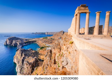 Rhodes, Greece. Lindos small whitewashed village and the Acropolis, scenery of Rhodos Island at Aegean Sea.