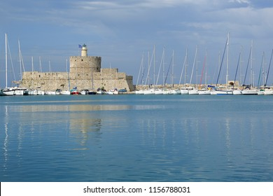 Rhodes, Greece - May 17, 2017: Mandraki harbor port and Fort of St. Nicholas with the Lighthouse in Rhodes island.