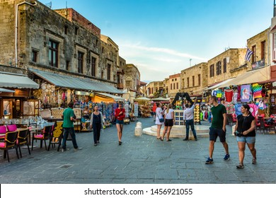 Rhodes, Greece - May 31, 2018. Hippocrates Square, people walking on the Medieval street in The Medieval Old Town of the City of Rhodes