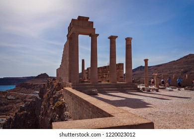 RHODES, GREECE - Oct 4, 2018: Tourists by the famous temple complex in Lindos village.