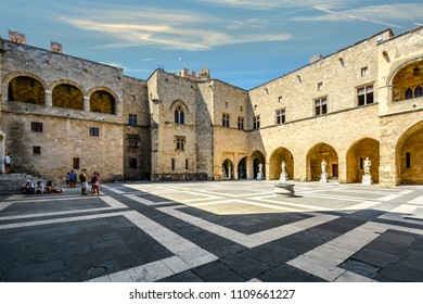 Rhodes, Greece - September 12 2017: Tourists relax in the shade inside the courtyard of the Palace of the Grand Master of the Knights of Rhodes on the Mediterranean island of Rhodes Greece.