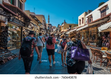 Rhodes, Greece - September, 2016: Tourists exploring the medieval streets of Rhodes Old Town.