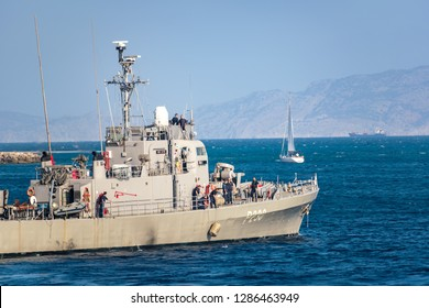 RHODES, GREECE – SEPTEMBER 21 2017: HS Ormi – Greek gunboat P230 (former Asheville-class gunboats of the US Navy transferred to Greece in 1989) leaves port in city of Rhodes. Turkey in background.
