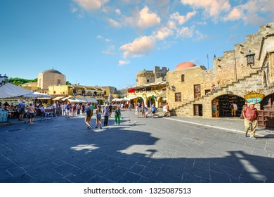 Rhodes, Greece - September 4 2018: Tourists sight-see, shop and dine in the historic Hippocrates Square, in the Old Town center of the island of Rhodes, Greece.