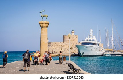RHODES, GREECE - SEPTEMBER 9 2018: Column with a statue of a deer at the entrance to the port of Mandraki Rhodes. Rhodes Island. Greece. Colossus of Rhodes near Old town.