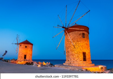 Rhodes, Greece. Stunning night image of Mandraki old harbour windmills in Dodecanese Islands.