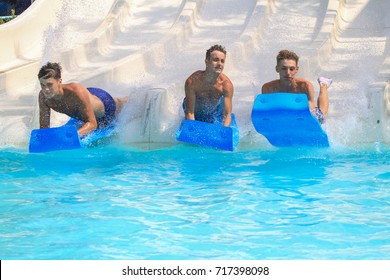 Rhodes, Greece-August  20,2017:Young boys  on the mat racer slide in Water park,Mat racer slide is very popular for young people in the Water Park.