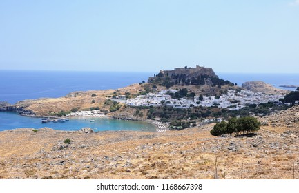 Rhodes İsland, Lindos. Greece. 07/27/2018.  Historic Lindos Town and the Acropolis. It is 50 km from Rhodes town. There are medieval village houses around the acropolis on the hill.