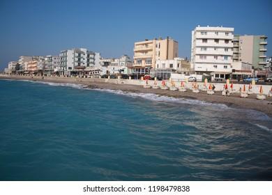 Rhodes: sept 2, 2018 - Rhodes island wihh cityscape of windy town beach. Rhodes is a popular summer tourist destination, Dodecanese, Aegean in Greece.