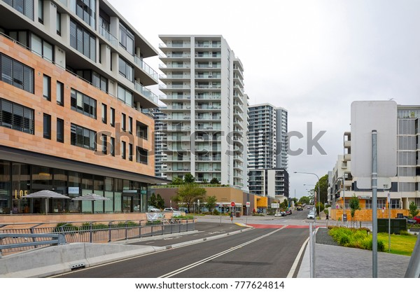 RHODES, SYDNEY, NEW SOUTH WALES, AUSTRALIA, 15 DECEMBER 2017: Residential area in the modern suburb of Rhodes with shops, restaurants and high-rise apartment buildings.