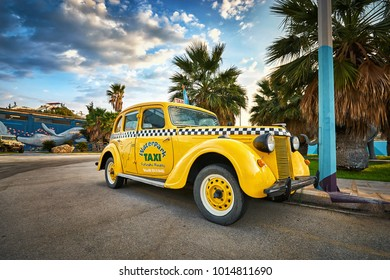 RHODES/GREECE - August 20, 2017: Retro yellow taxi car in the Rhodes aquapark