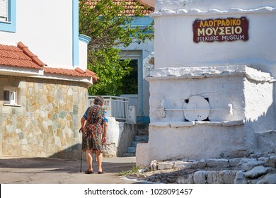 RHODES/GREECE - August 25, 2017: Old  woman walking at the street of Embonas village at Rhodes island