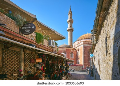 RHODES/GREECE - August 27, 2017: Street of old Rhodes city with Mosque of Suleiman at the background