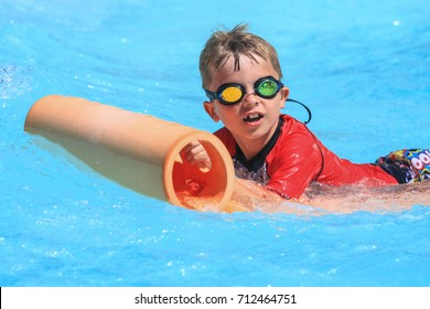 Rhodes,Greece-August 13 ,2017:The young boy on the mat racer slide in Water park,Mat racer slide is very popular for young people in the Water Park.
