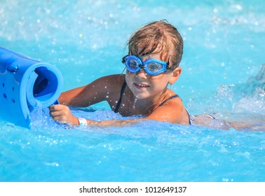 Rhodes,Greece-August 25,2017:The girl on the mat racer slide in Water park,Mat racer slide is very popular for young people in the Water Park