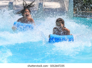Rhodes,Greece-August 26,2017:Two girls on the mat racer slide in Water park,Mat racer slide is very popular for young people in the Water Park