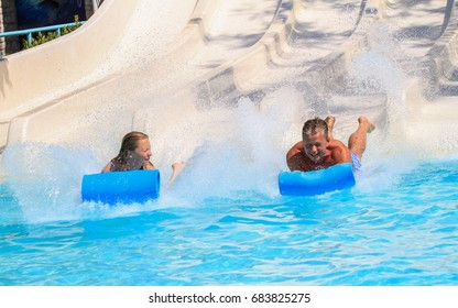 Rhodes,Greece-July 16,2017:The couple on the mat racer slide in Water park,Mat racer slide is very popular for young people in the Water Park