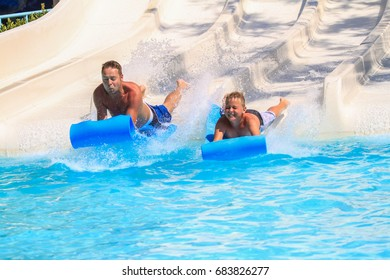 Rhodes,Greece-July 16,2017:The family on the mat racer slide in Water park,Mat racer slide is very popular for young people in the Water Park