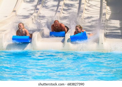 Rhodes,Greece-July 19,2017:The family on the mat racer slide in Water park. Mat racer slide is very popular for young people in the Water Park