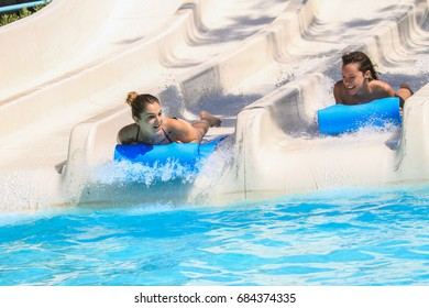 Rhodes,Greece-July 23,2017:Two girl on the mat racer slide in Water park,Mat racer slide is very popular for young people in the Water Park