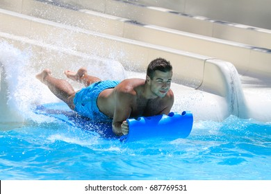 Rhodes,Greece-July 28,2017:The young man on the mat racer slide in Water park,Mat racer slide is very popular for young people in the Water Park