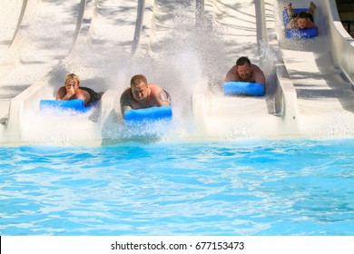 Rhodes,Greece-July,10,2017:People on the mat racer slide in Water park,Mat racer slide is very popular for young people in the Water Park.