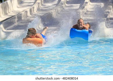 Rhodes,Greek-September 11,2016:Two young boys on the mat racer slide in Water park,Mat racer slide is very popular for young people in the Water Park. Water Park is located on the island of Rhodes